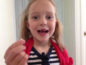 Hadley with her first top tooth gone!