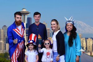 Cheesy tourist pic on our way up the Space Needle (Hadley as Uncle Sam) and Lydia as our Lady Liberty